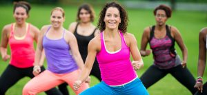 Group of diverse women doing outdoor zumba